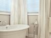Elegant Neutrals Ensuite Soaker Tub Silk Drapes