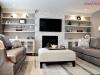 Family Room Renovation Custom Built-Ins White Ledgestone Fireplace